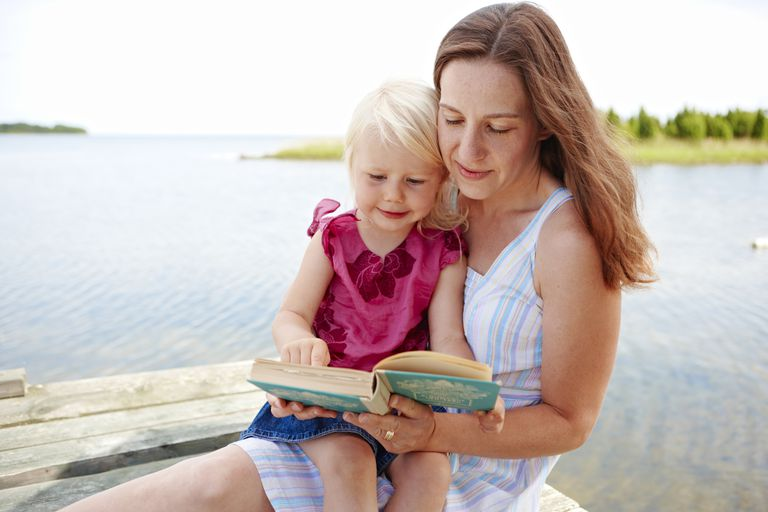 Woman reading book to child
