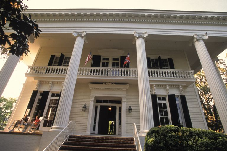 Front view of mansion with two-story fluted columns supporting a two-story front porch (portico)