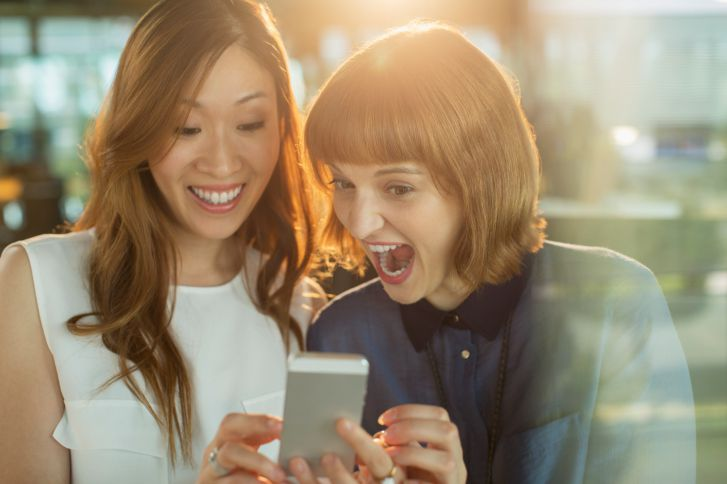 Two Women Looking at Smartphone