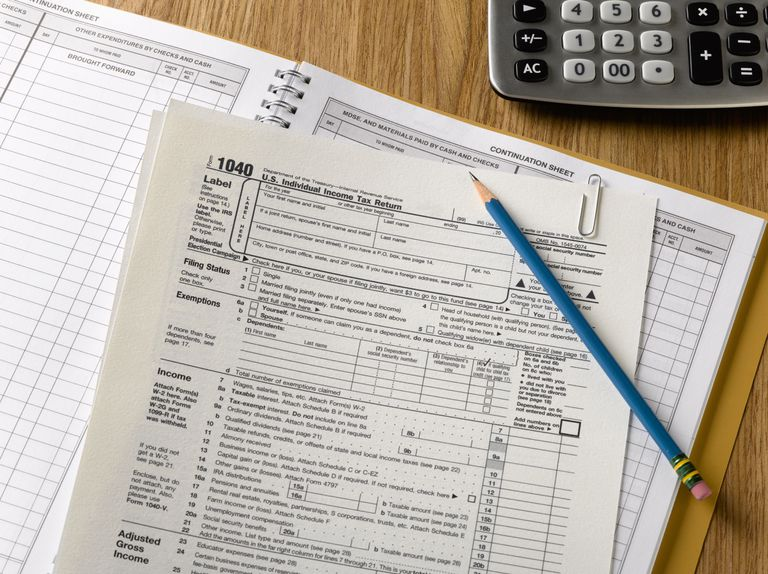 tax forms with pencil and calculator