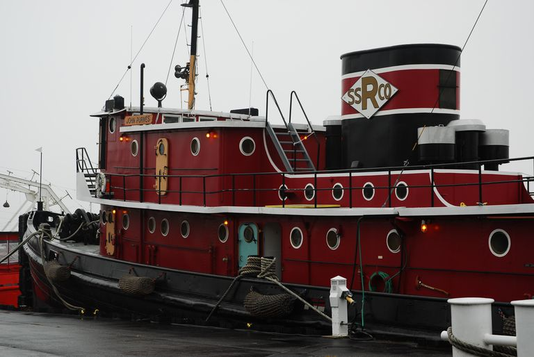 Tugboat John Purves Shines in Red and Black as She Sits Dockside.