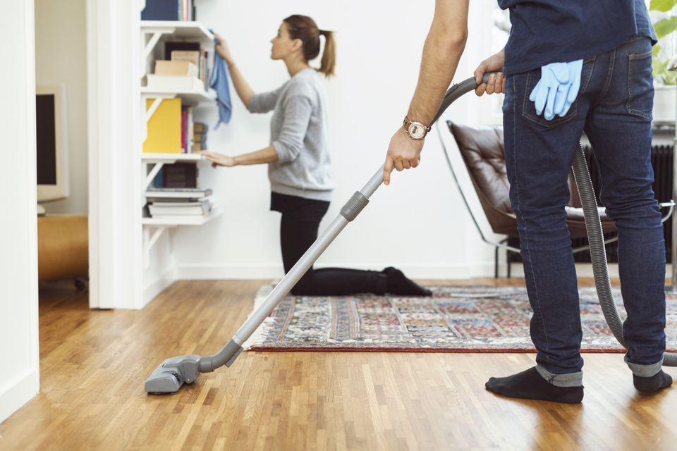 Man and woman cleaning house