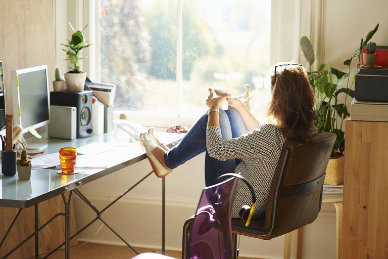Woman alone looking through window