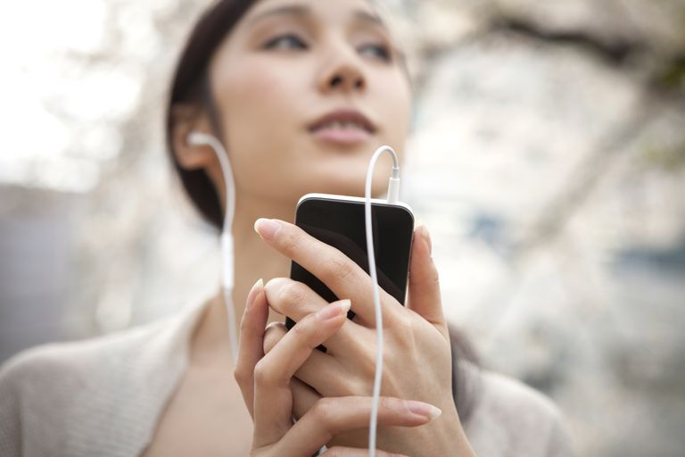 woman listening to ipod with headphones