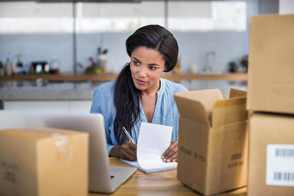 Woman running her business from home preparing shipments