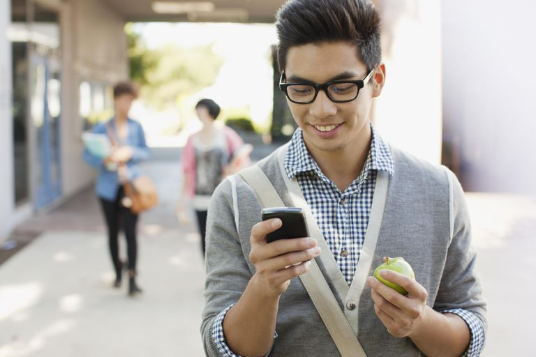 Student using cell phone outdoors