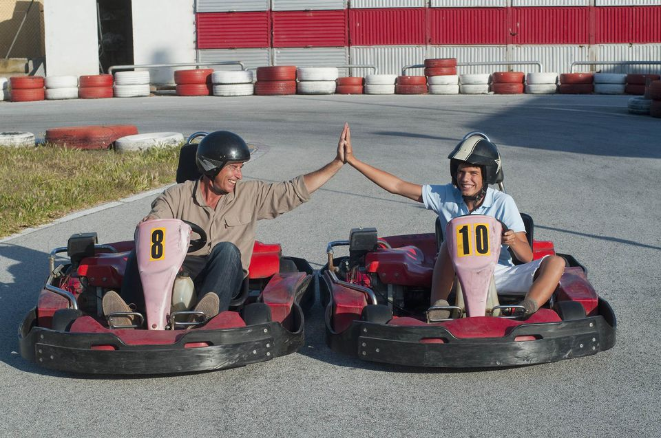 A picture of a father and son on go carts