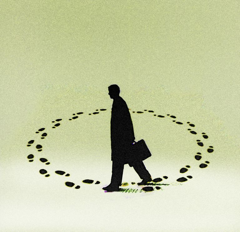 businessman walking in an endless circle