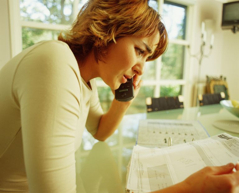 Woman on the phone worried about debt