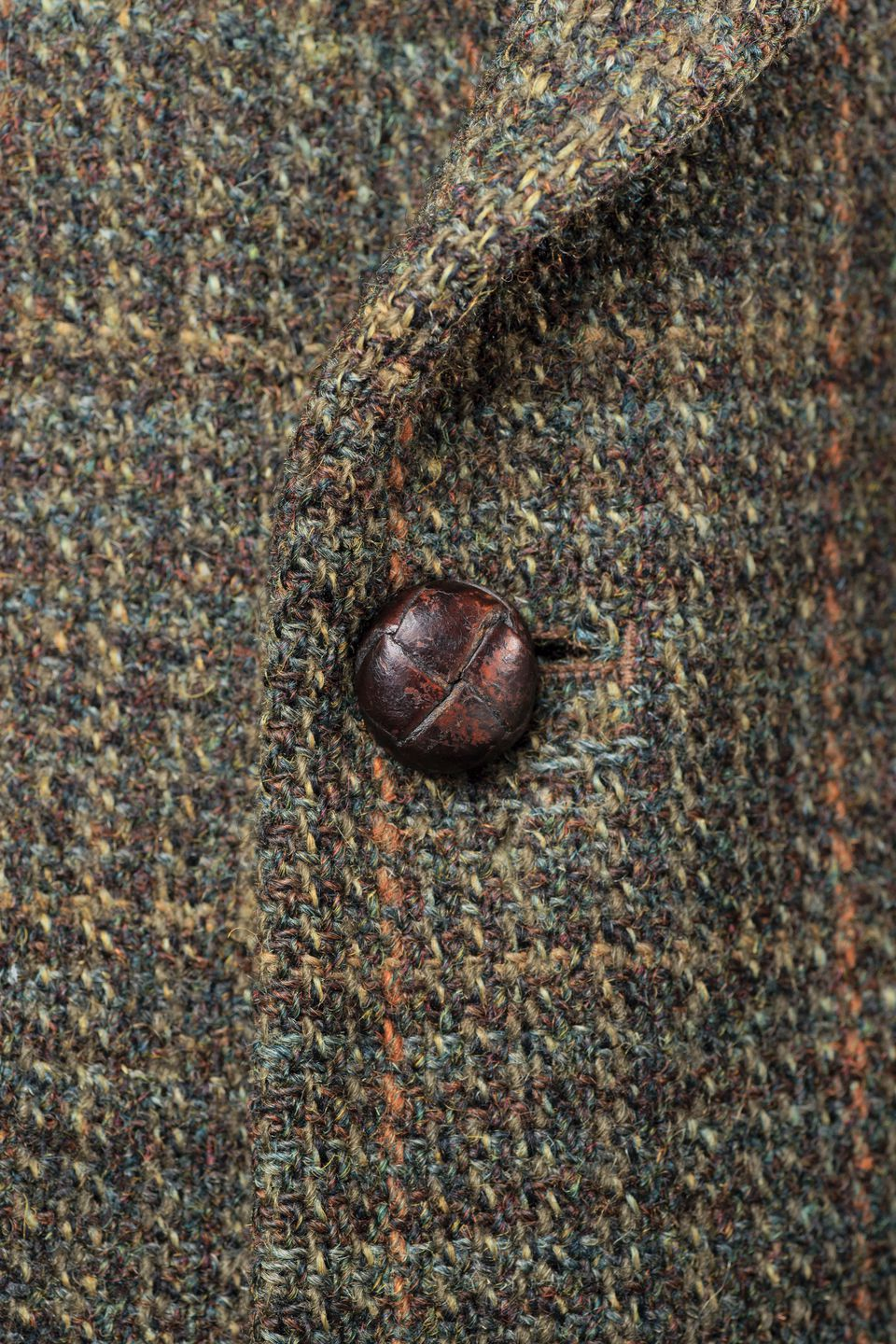 'Buttoned Harris tweed jacket, detail.'
