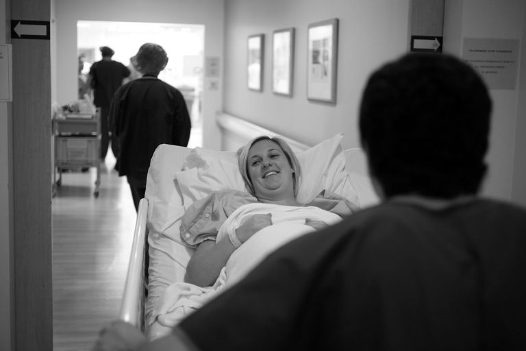 A mother on her way to the operating room for a cesarean.