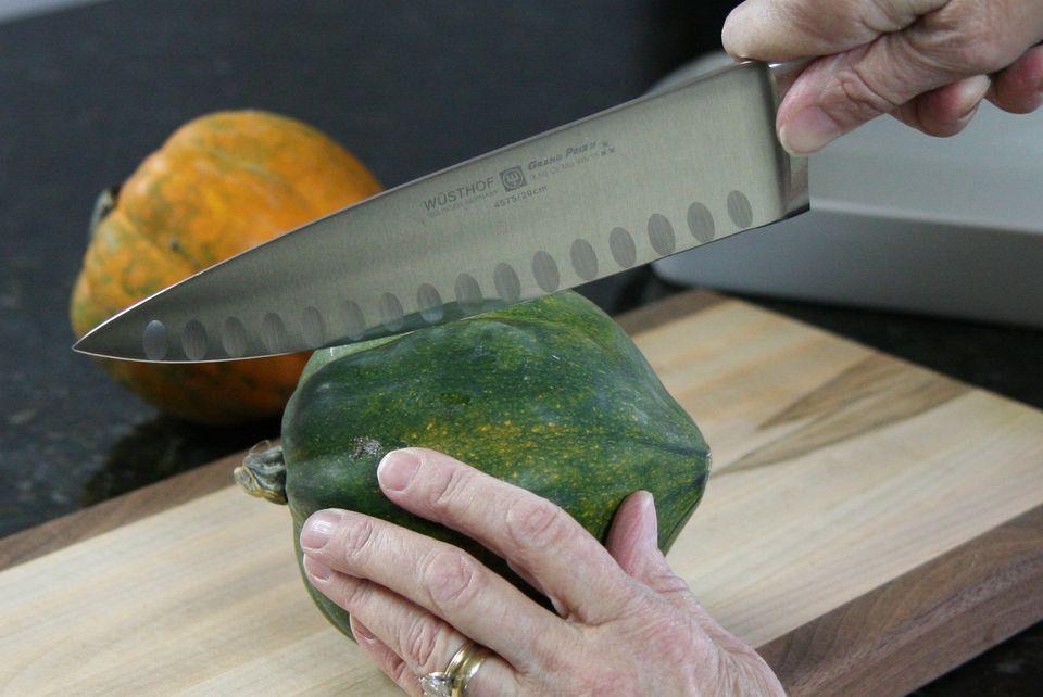 Cutting Acorn Squash - Photo Credit: Diana Rattray