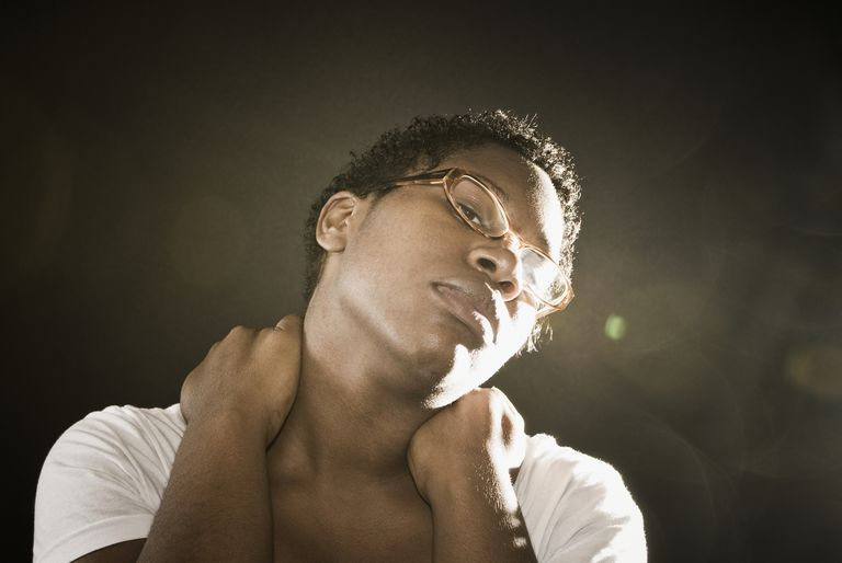 African American Woman Rubbing Neck