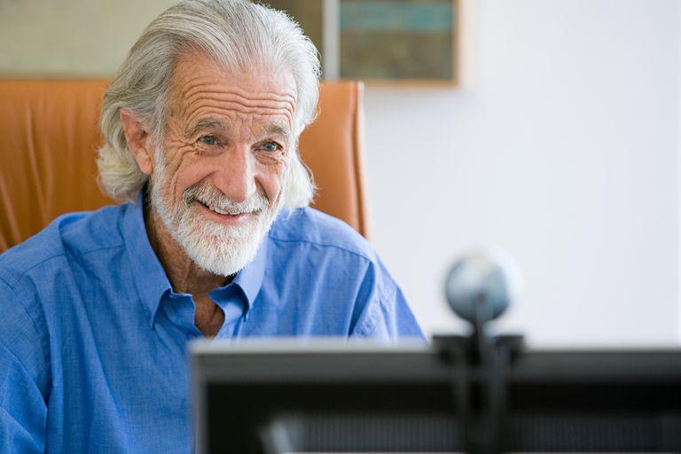Senior man with webcam