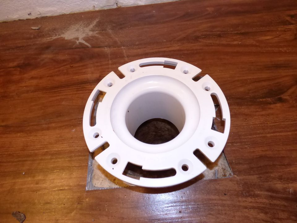 Toilet Flange Resting In Place In Sewer Pipe