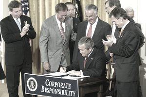 U.S. President George W. Bush signs the Corporate Reform Bill in 2002.