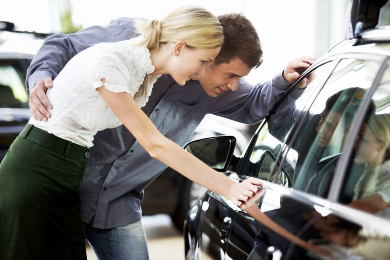 Young Couple Looking to Buy a New Car