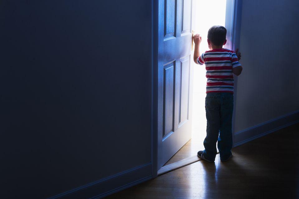 kid opening door