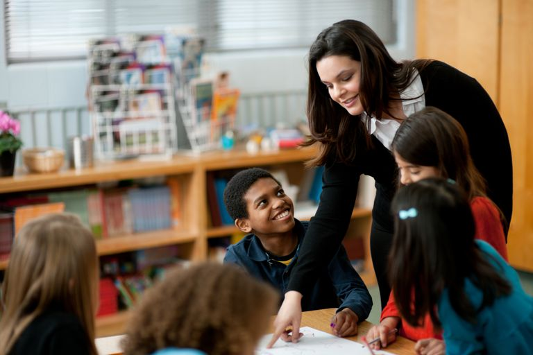 third graders in class with teacher