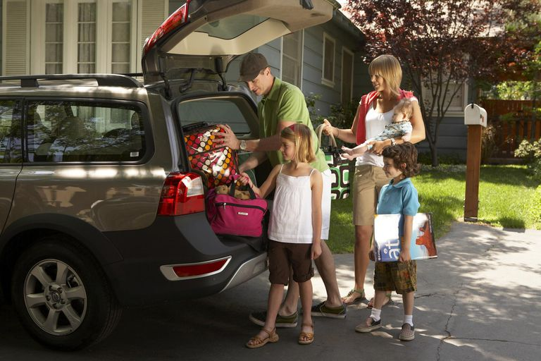 Family packing car for trip.