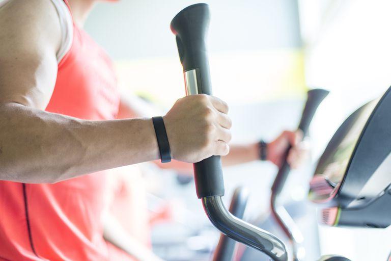 close up of man on elliptical trainer exercise machine