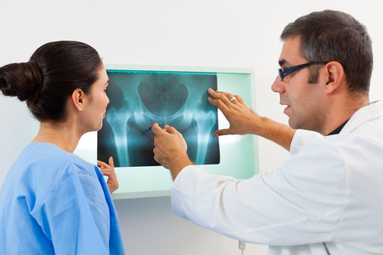 radiologist discussing x-ray with woman