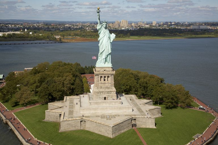 Overhead photo of the Statue of Liberty atop a star base and concrete pedestal