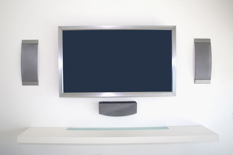 A home theater setup with in-wall speakers.