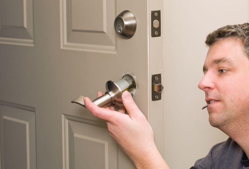 Worker Replacing Hollow Core Door