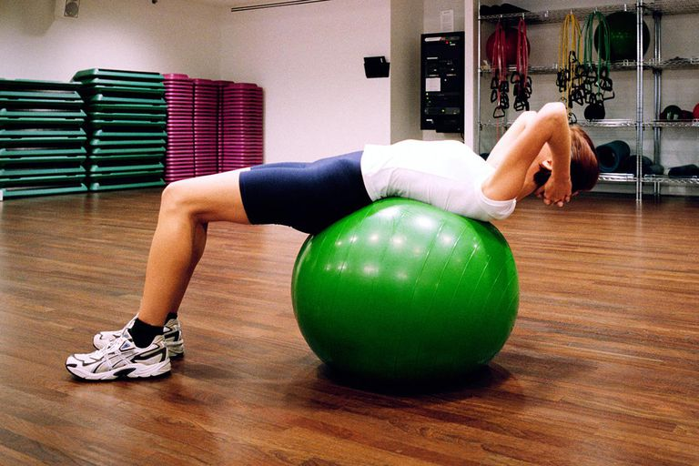 Woman on Pilates ball