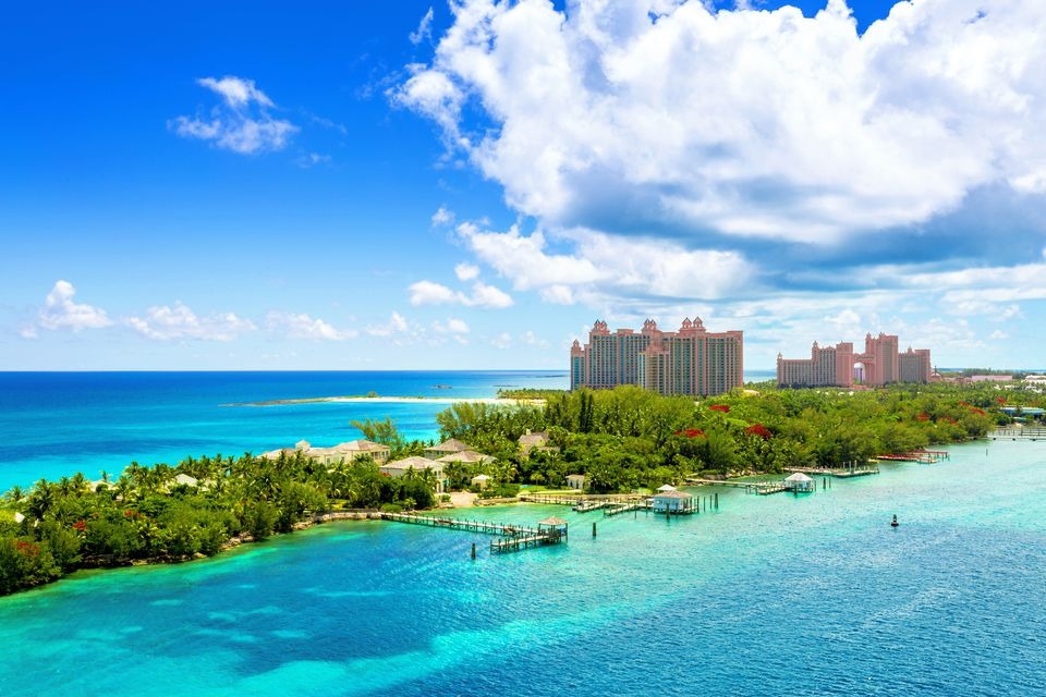 Scenic view of an idyllic beach at Nassau, Bahamas, on Paradise Island. Caribbean and tropical beach scene at Nassau with white sand coastline and deep blue sea, Bahamas. Atlantis Caribbean beach resort at Nassau, Bahamas.