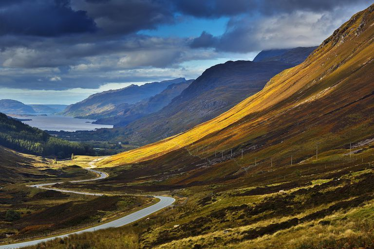 United Kingdom, Scotland, Wester Ross, Glen Docherty, natural horizontal landscape of a valley that ends in a Scottish loch surrounded by mountains under a stormy sky