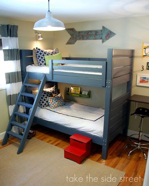 A blue bunk bed with a ladder