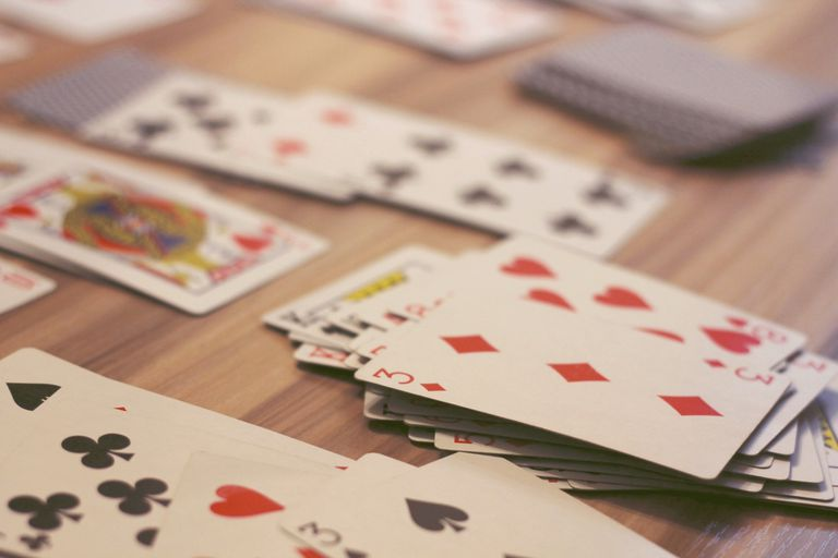 High Angle View Of Cards On Table