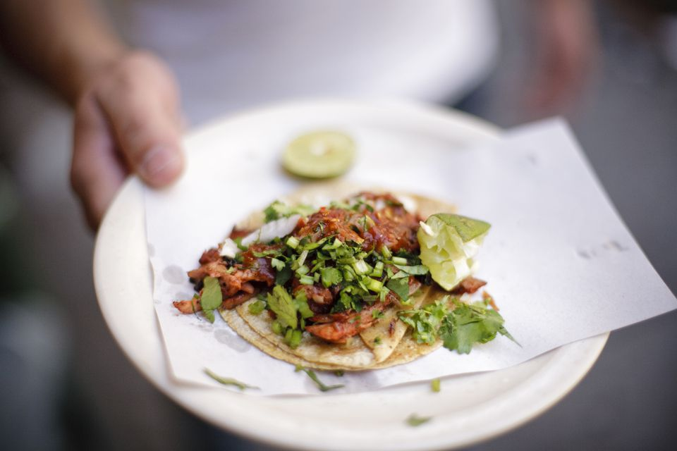 Taco being served from a street vendor in Mexico City, Mexico