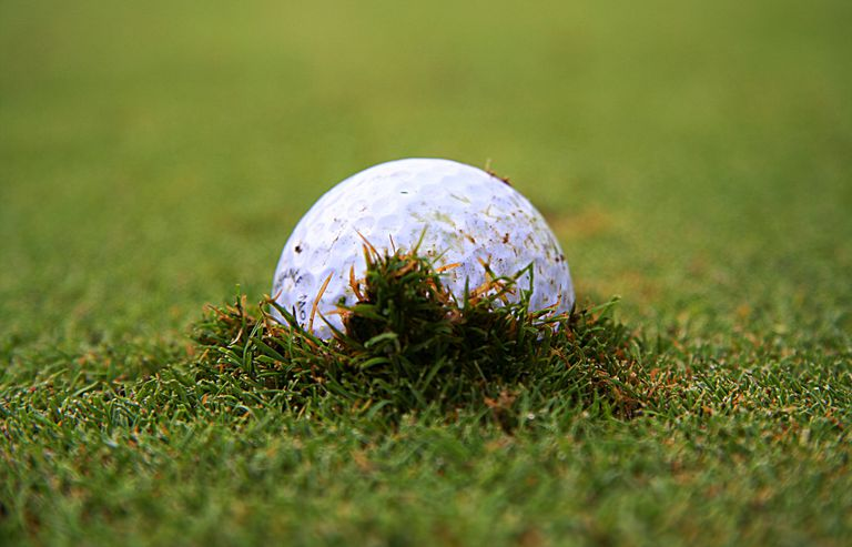 A embedded golf ball in the fairway