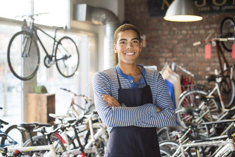Young man working in bike shop
