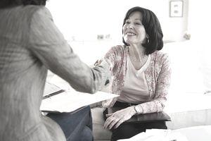 Woman choosing an independent financial advisor.