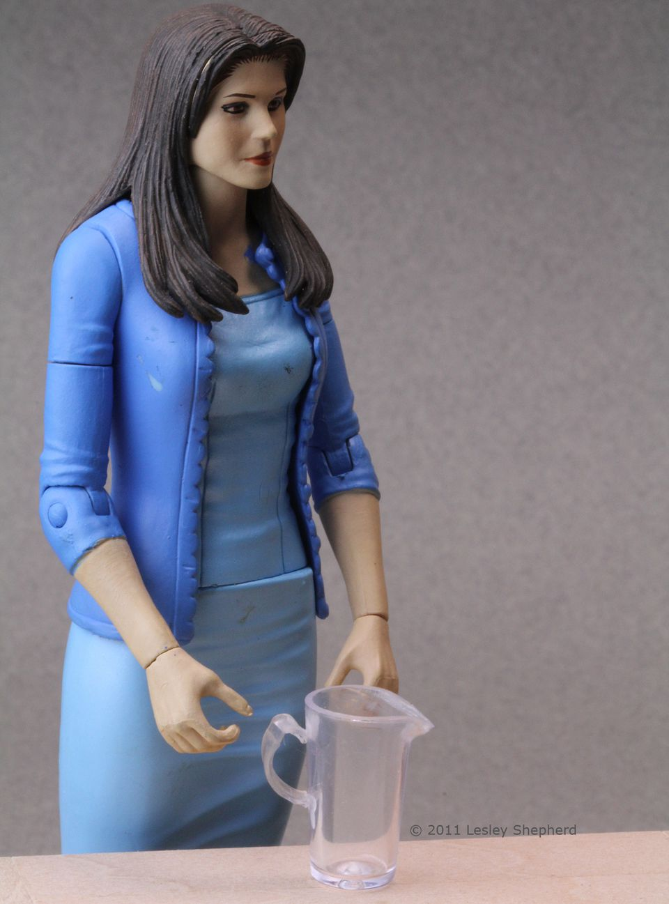 Six inch plastic action figure shown with a miniature dollhouse pitcher made from a pencil cap