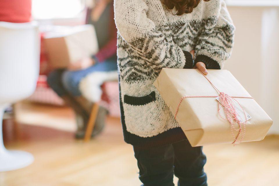 Child holding present