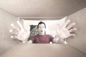 Guy looking in empty box