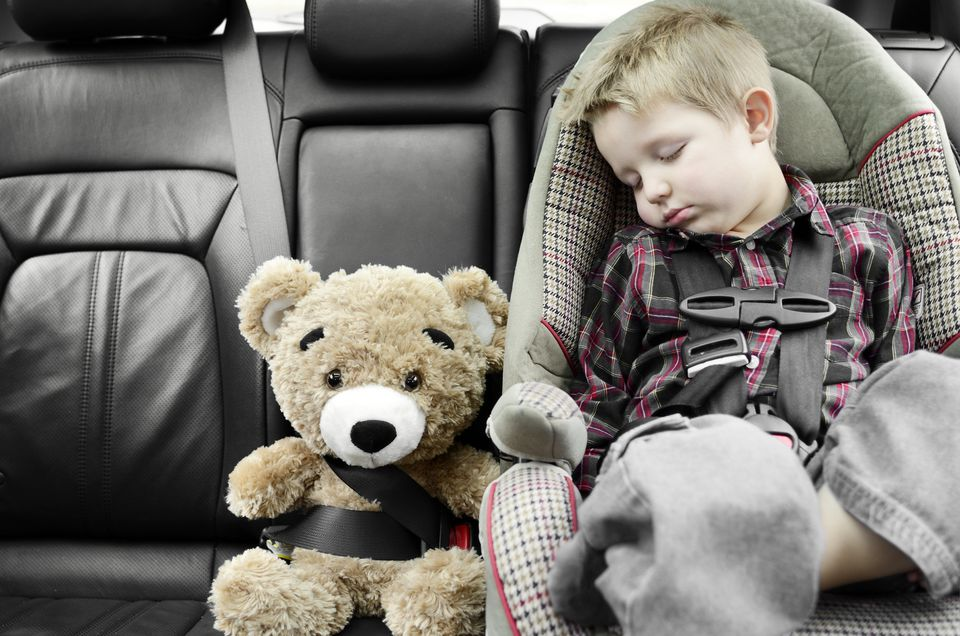 Boy Sleeping in Car Seat