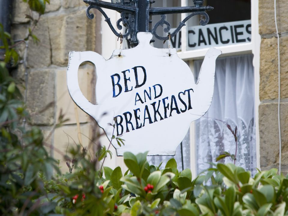 Teapot-shaped sign outside bed and breakfast. Alnwick, Northumberland, England, United Kingdom, Europe