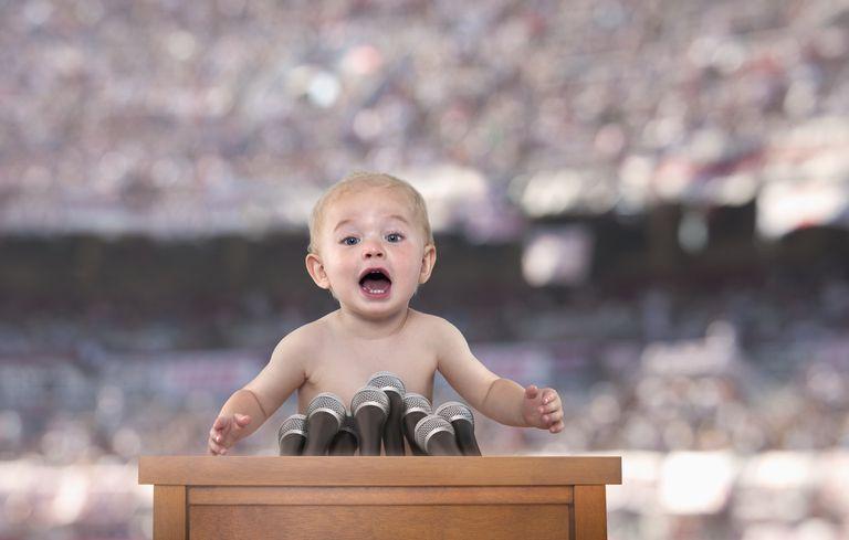 claim - baby at podium