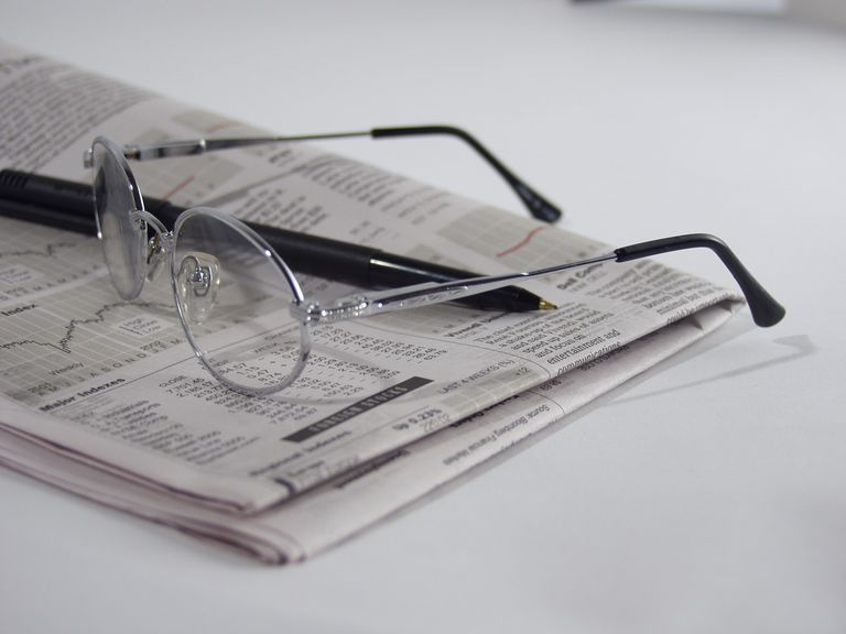 A newspaper open to the business page