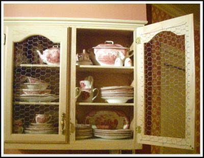 Makeover a Cabinet Door With Chicken Wire Panels