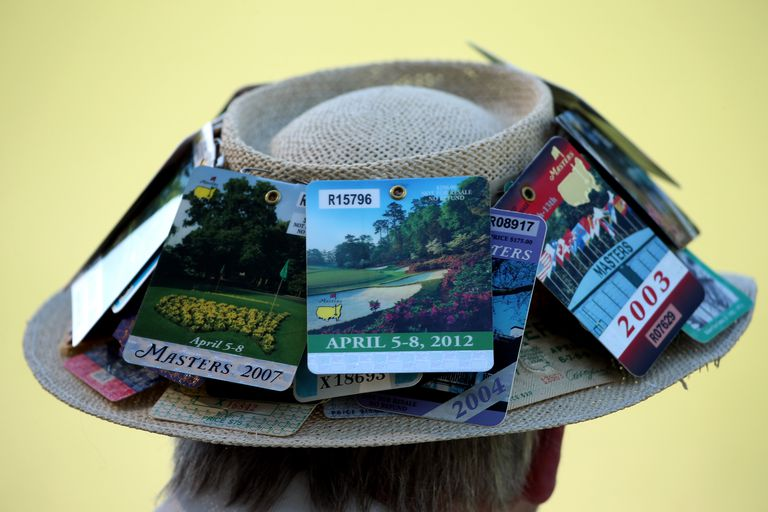 Masters tickets displayed on a hat worn by a fan