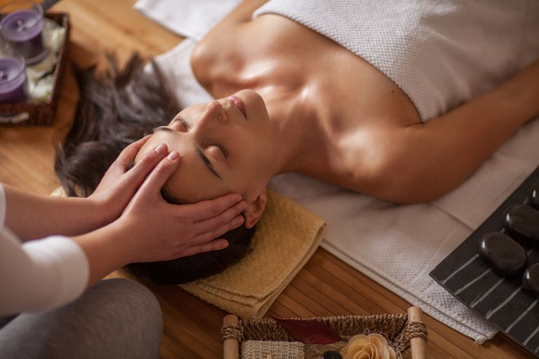 Woman receiving massage therapy for anxiety