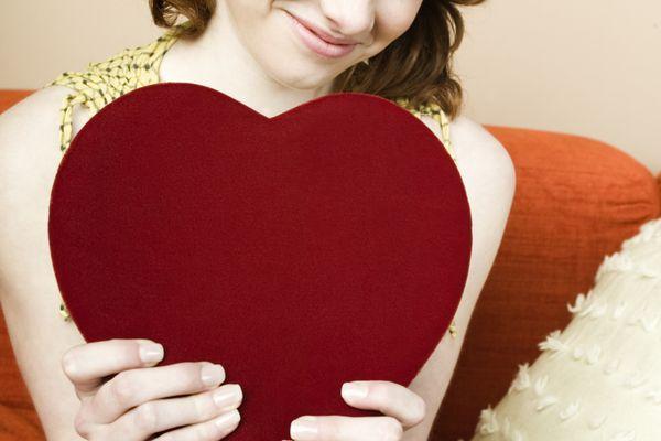 teenager holding heart shaped box