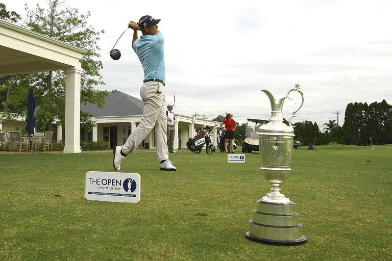 Golfers play in British Open qualifying tournament.